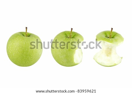 The sequence of a green apple being eaten to its core showing, isolated against white. - stock photo