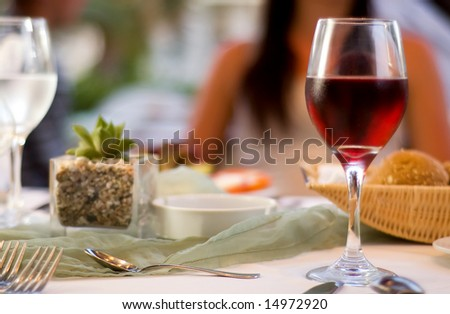 The served table with red wine at restaurant (shallow dof)