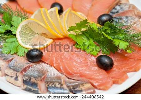 The set marinated mackerel, herring fillet, and salmon - stock photo