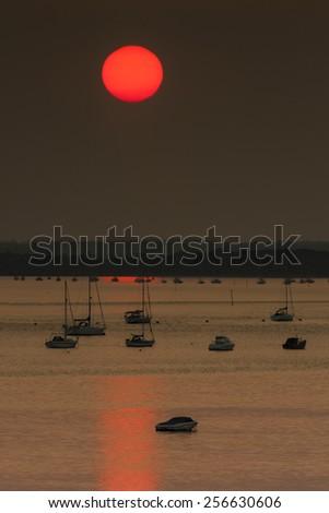 The setting sun illuminates the scene in one of the most beautiful areas of Dorset - stock photo
