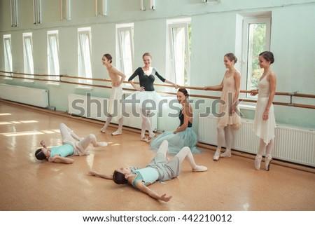 The seven ballerinas at ballet bar - stock photo