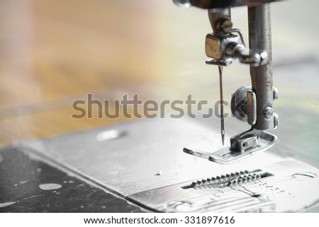 the sewing machine and item of clothing, Detail of sewing machine and sewing accessories, old sewing machine. - stock photo