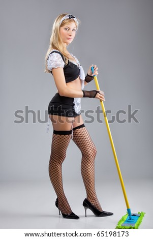 The sexy cleaner, isolated  on a white background - stock photo