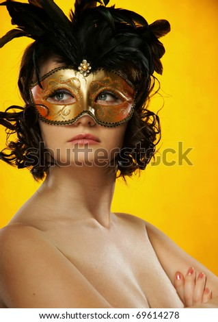 The sexy girl in a mask - stock photo