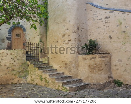 The Shaded Back Entrance to the Church, St Tropez, France That Almost Looks Like Water Color Painting - stock photo