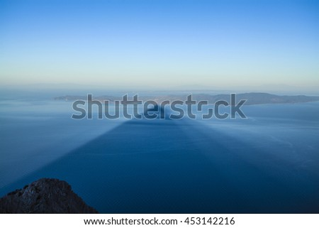 The shadow of the Holy Mount  is seen over the Halkidiki peninsula during sunrise