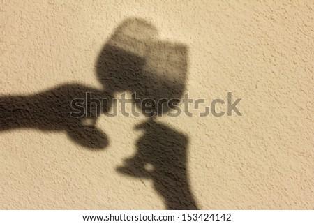 the shadow of two wine glasses - stock photo