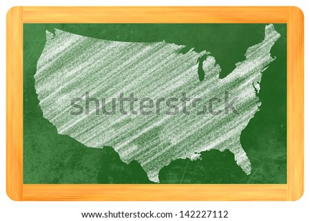 the shape of the usa drawn on a blackboard - stock photo