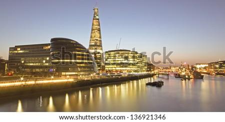 The Shard Skyscraper along the Thames River bank London UK - stock photo