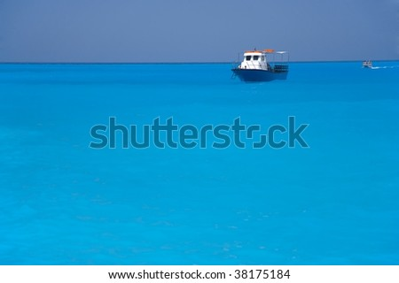 The ship and the boat in the sea - stock photo