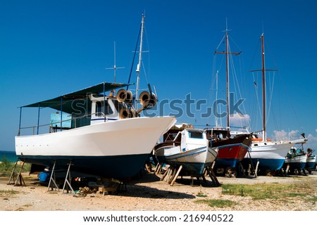 The ship at shipyard for paint and repair - stock photo