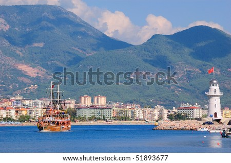 The ship floats near a beacon. Alanya. Turkey
