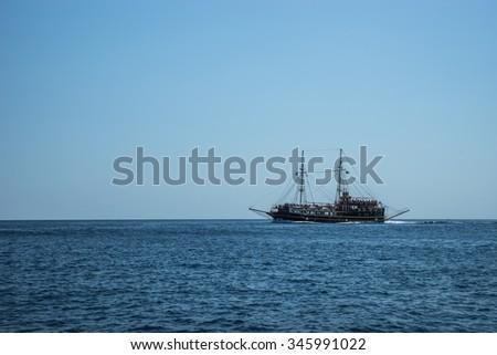 The ship on the horizon - stock photo