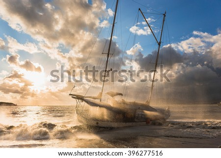 The ship, storm, sunset - stock photo