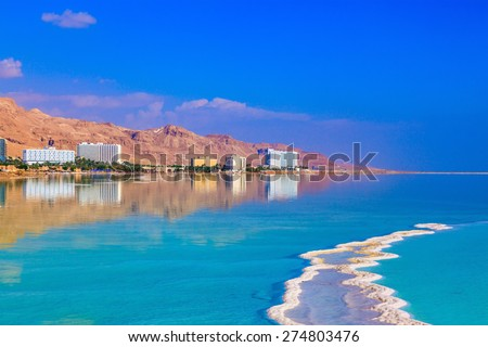 The shoaled Dead Sea at coast of Israel. Emerald water of the Dead Sea - stock photo