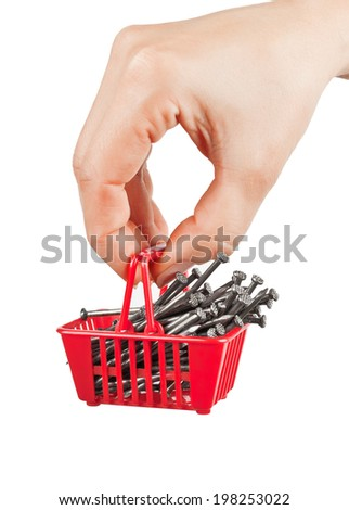 The shopping cart with nails in his hand on a white background - stock photo