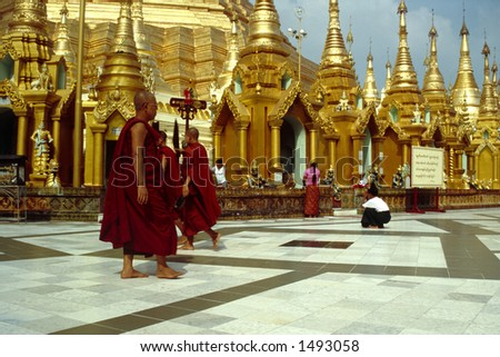 The Shwedagon pagoda in Yangon (Myanmar) is one of the most breathtaking places of worship on our planet. Every good Buddhist in Myanmar hopes to make a pilgrimage here at least once in their lifetime - stock photo