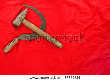 The sickle and the hammer communist symbol on a soviet flag. - stock photo
