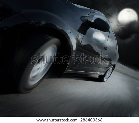 The Side view of black car in turn