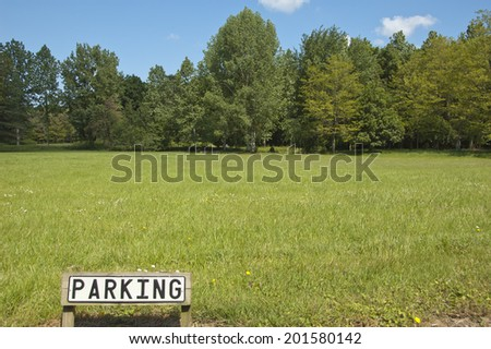 The sign of parking on the background of natural landscape