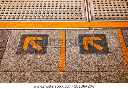 The Sign of yellow arrow on floor - stock photo