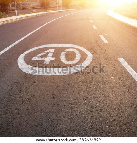 The sign on the pavement of the limitation of speed. Concept restrictions of something