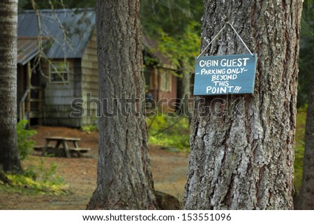 The sign that says �Cabin Guest Parking Only Beyond This Point!!!� is put in a place to keep others from parking in that area.