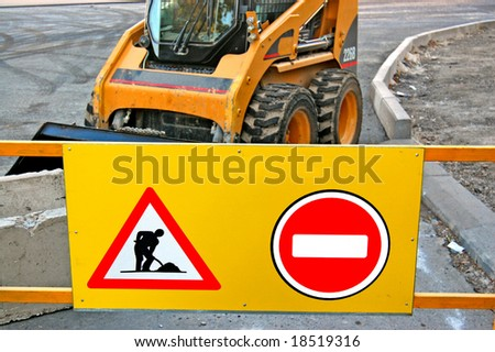 The Sign `Work` and Loader - stock photo