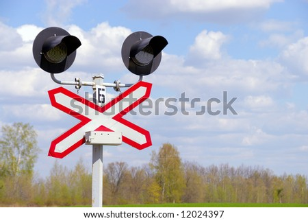 The signal system protecting a railway crossing from a highway, according to rules of traffic - stock photo