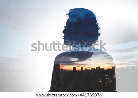 The silhouette of Asian man standing.