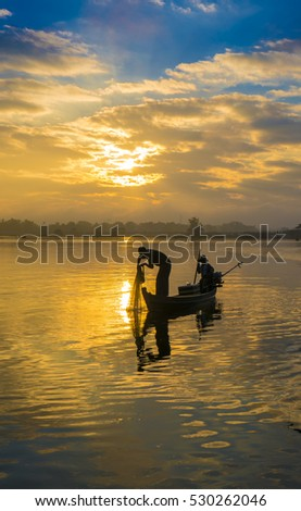 The silhouette of Local Fishermen in a boat near U Bein Bridge, Amarapura, Mandalay region, Myanmar