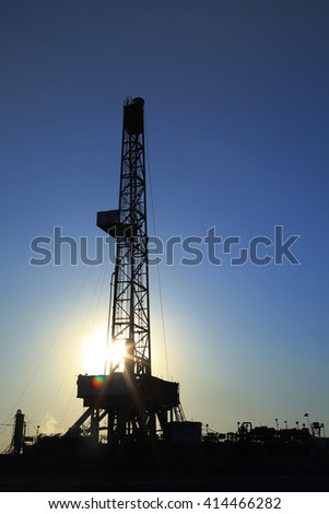 The silhouette of oilfield derrick