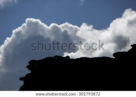 The silhouette of the cliffs of Kukenan tepui or Mount Roraima  with clouds and blue sky. Gran Sabana. Venezuela 2015. - stock photo