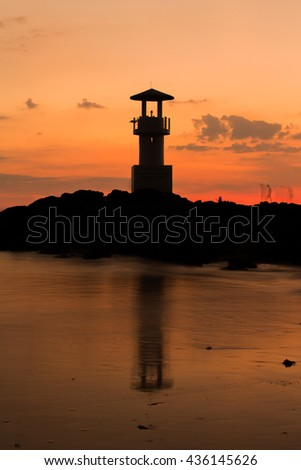 The silhouette of the lighthouse with the evening light.