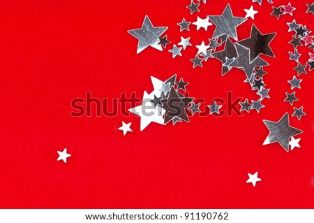 The silver stars on the red background .