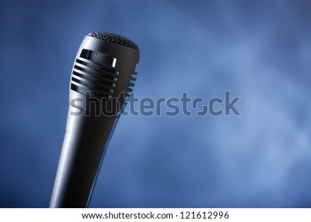 the single microphone on the dark background