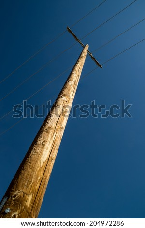 The single telephone pole with the deep blue California skies above. - stock photo