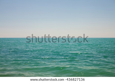 The sky and sea with reflections of sunlight - stock photo