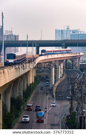 The Sky train in Bangkok with building