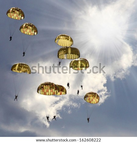 The skydivers on stormy sky. - stock photo