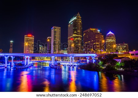 The skyline and bridges over the Hillsborough River at night in Tampa, Florida. - stock photo