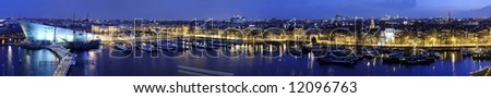 The skyline of Amsterdam, the Netherlands at dusk - stock photo
