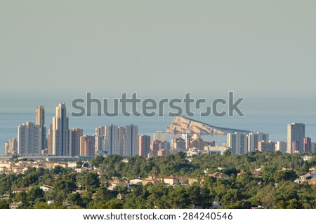 The skyline of Benidorm and its surrounding residential areas - stock photo