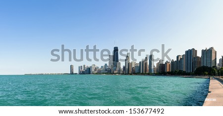 The skyline of Chicago under the blue sky with the lake Michigan