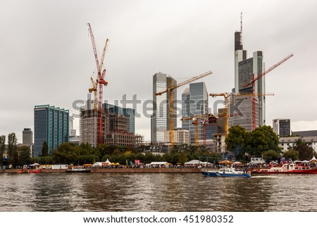 The skyline of Frankfurt's financial district - under dark clouds and with many conversions. A symbol of our ailing financial system? - stock photo