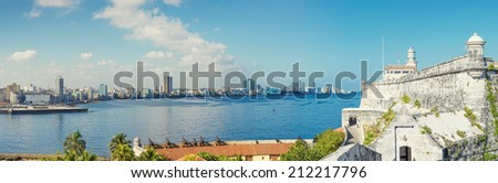 The skyline of Havana with El Morro castle on the foreground - stock photo