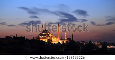 The skyline of Istanbul at night with mosques and churches illuminated - stock photo