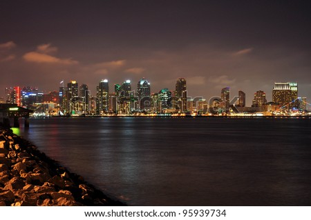 The skyline of San Diego, California is viewed at night from Harbor Island. - stock photo