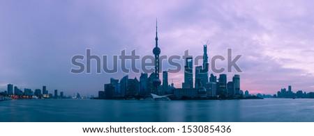 The skyline of Shanghai against a brilliant purple dawn. - stock photo