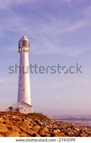 The Slangkop Lighthouse in Kommetjie, Western Cape. The tallest lighthouse in South Africa. - stock photo